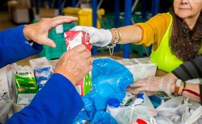 La Obra Social 'la Caixa' y el Banco de Alimentos de Burgos impulsan la gran recogida de leche para combatir la pobreza alimentaria