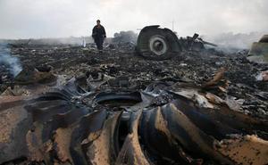 La Justicia holandesa acusa a tres rusos y a un ucraniano por derribar el avión malasio y pide a Rusia que coopere